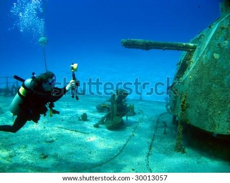 Underwater photographer shooting the MV Tibbetts in Cayman Brac - stock photo