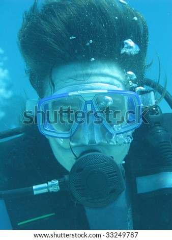 Underwater photographing, Diver in blue sea. Philippines - stock photo