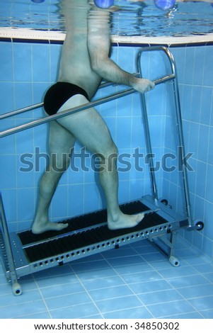 Underwater picture - man exercising on a Treadmill. - stock photo