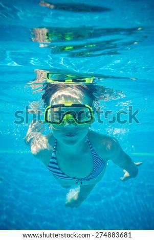 Underwater portrait of happy child. Summer vacation - stock photo