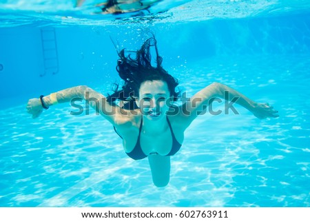 Young Woman Under The Spray Of Water. Wet Hair Woman