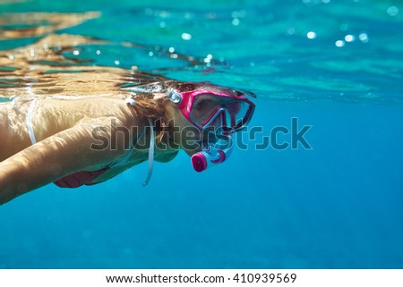 underwater portrait of young lady snorkeling in mask. vacation concept - stock photo
