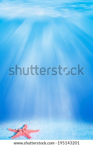 underwater scene with sun rays and starfish - stock photo