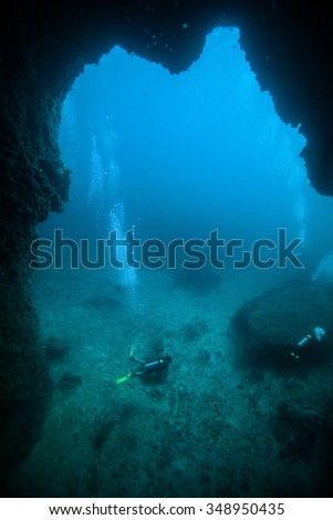 Underwater sea and scuba divers - stock photo