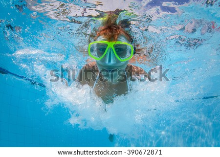 Underwater shoot of the lady in mask in the swimming pool