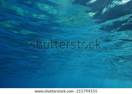 Underwater shot with sunrays in deep tropical sea, bright blue clear water. Background texture photographed in Naxos, Greece.  - stock photo