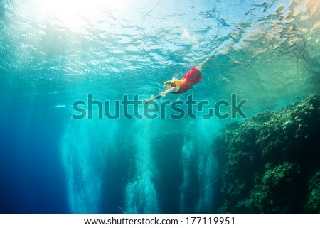underwater swimming with corals - stock photo
