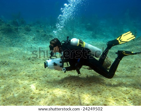 Underwater Videographer shooting on a Cayman Island Reef - stock photo