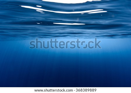 Underwater view of the calm sea surface - stock photo