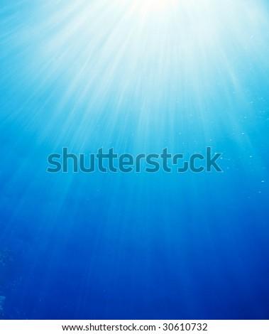 Underwater World, Sun Rays Filtering Down Through Ocean - stock photo