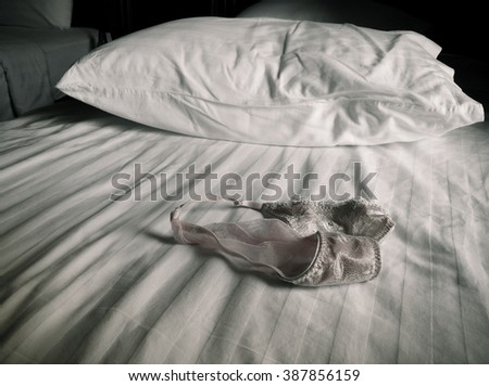 Underwear on the bed. black and white style - stock photo