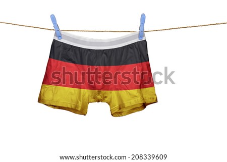 Underwear with the Germany flag on a string against clear blue sky - stock photo