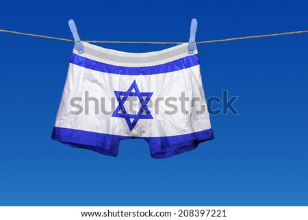 Underwear with the Israel flag on a string against clear blue sky - stock photo