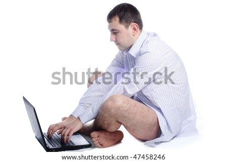 Undressed man working at laptop isolated on white - stock photo