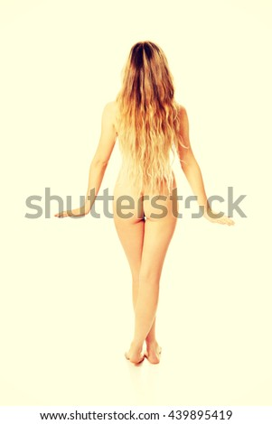 Undressed woman standing back to camera - stock photo