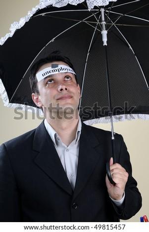 unemployed man praying for job - stock photo