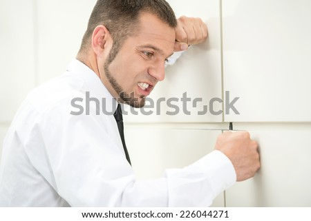 Unemployed young man, stressed for there is no work. - stock photo