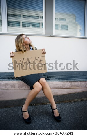 Unemployed Young Woman Asking For A Job - stock photo