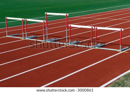 Unequal hurdles on race track - stock photo