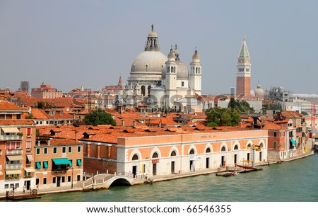 UNESCO World heritage city Venice, Italy at the sea with old houses, church Santa Maria del Salute,channels and ferries - stock photo