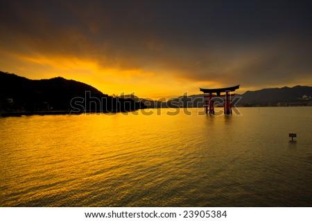 Unesco world heritage shrine gate at sunset - stock photo
