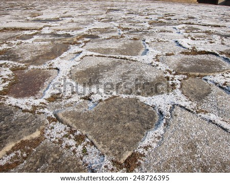 Uneven stone flooring walkway to temple - stock photo