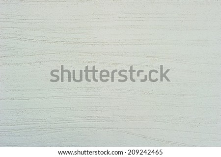 Uneven surfaces of cement are putty on the walls. - stock photo