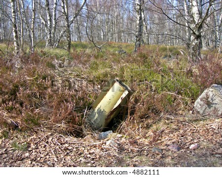 Unexploded rocket buried in the birch forest - stock photo