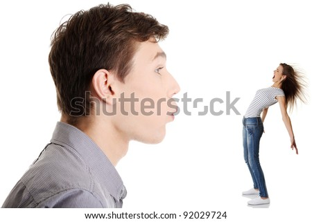 Unfair competition concept. Man blowing on women - stock photo