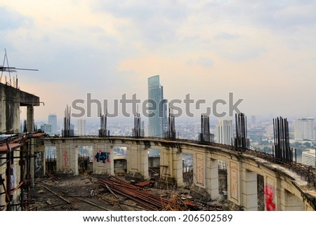 Unfinished abandoned skyscraper Sathorn Unique - stock photo