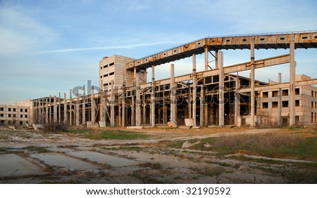 Unfinished and abandoned industrial building inevitably decaying somewhere in the Eastern Europe - stock photo