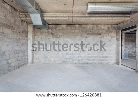 Unfinished building interior, empty room with conditioning canals - stock photo
