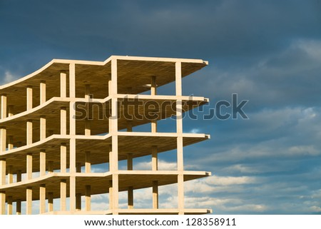 Unfinished building with its basic structure complete - stock photo