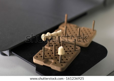 unfinished ceramic crowns - stock photo
