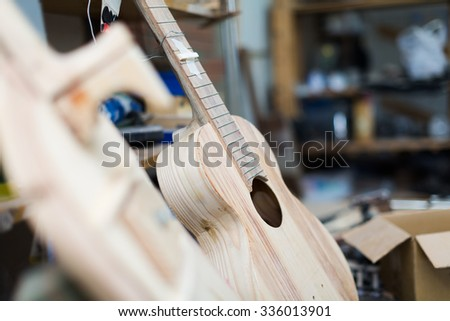 Unfinished classic guitar  at workshop   - stock photo