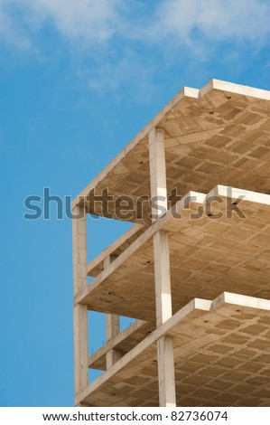 Unfinished concrete structure of a high rise building - stock photo