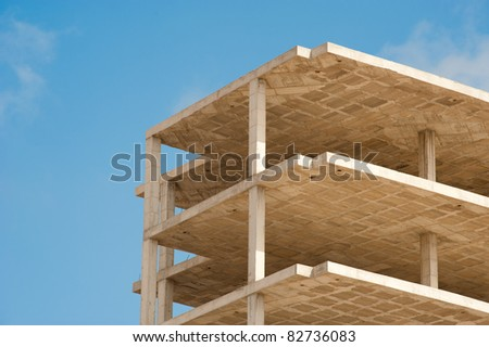 Unfinished concrete structure of a high rise builing - stock photo