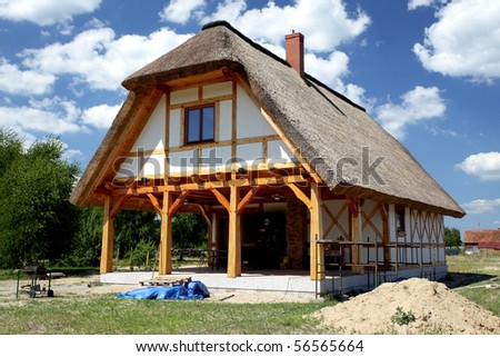 Unfinished, ecological rural wooden house almost ready to live - stock photo