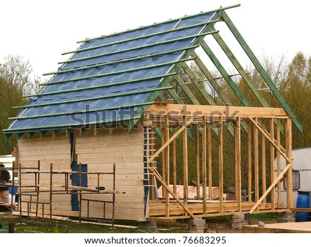 Unfinished, ecological wooden house - stock photo
