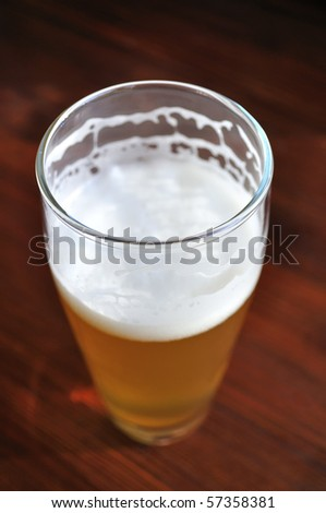 Unfinished Glass of Unfiltered Beer - stock photo