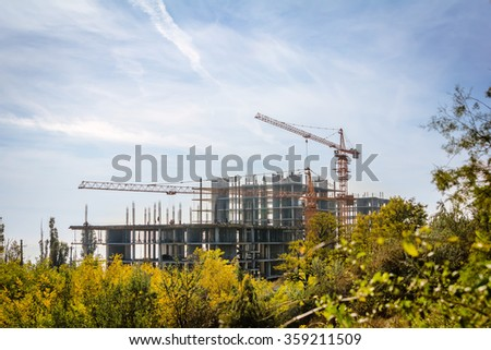 Unfinished high-rise apartment building - stock photo