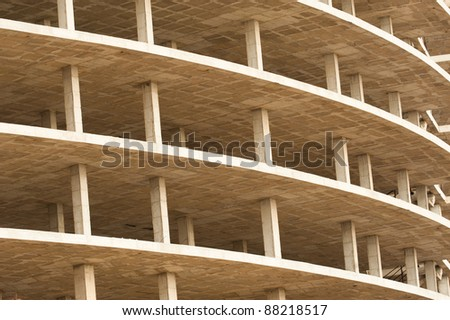 Unfinished high rise building concrete structure, a background - stock photo