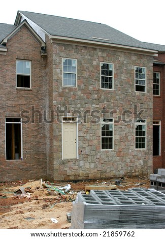 Unfinished homes in a slow housing market. - stock photo