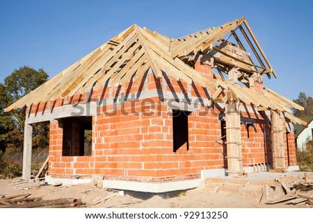 Unfinished house of brick, still under construction - stock photo