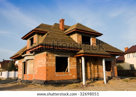 Unfinished house, still under construction - stock photo