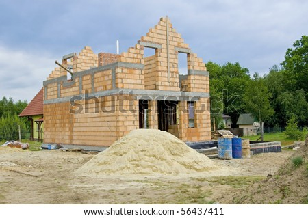 Unfinished, one family house made of brick - stock photo