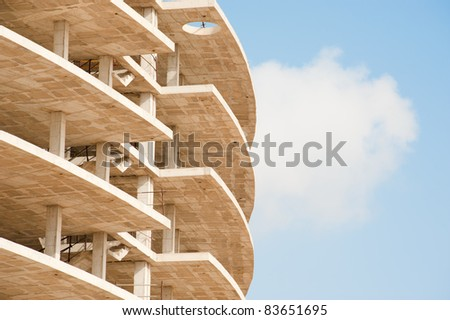 Unfinished prefab structure of a high rise building - stock photo