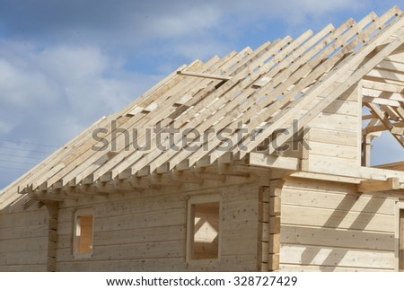 Unfinished roof in wooden home. - stock photo