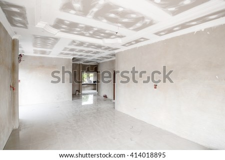 unfinished room of inside house under construction - stock photo