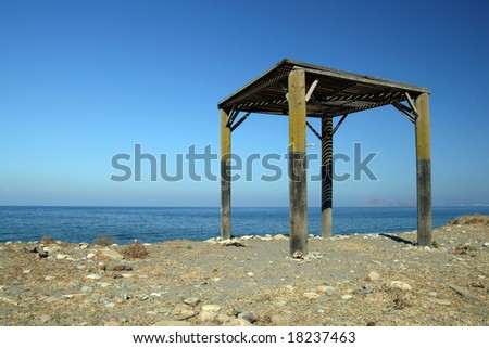 Unfinished summerhouse construction on the beach - stock photo
